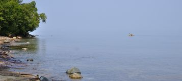 Kayaker on Lake Superior on a calm summer day Stock Photos