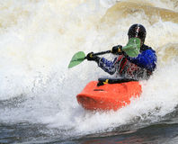 Kayaker with Paddle Up Stock Images