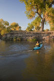 Kayaker paddling across a river Royalty Free Stock Images