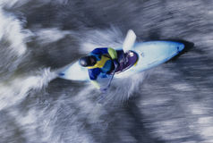 Kayaker Paddling Through Rapids Royalty Free Stock Photos