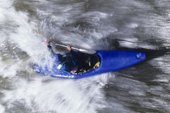 Kayaker Paddling Through Rapids Stock Images