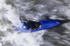 Kayaker Paddling Through Rapids Stock Images