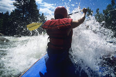 Kayaker Paddling Through Rapids Royalty Free Stock Images