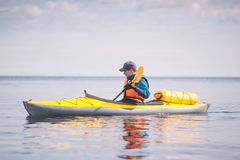 Kayaker paddling on the sea. Royalty Free Stock Images