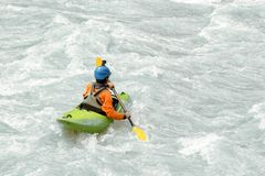 Kayaker paddling in white water rapids, with copy space. Kayaker paddling in white water rapids,  with copy space Royalty Free Stock Photo