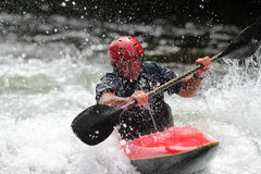Kayaker playing in the rapids Stock Images