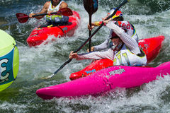 Kayaker racing at payette river games Stock Photography