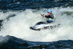 Kayaker riding a wave Royalty Free Stock Image