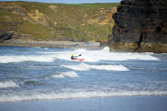 Kayaker riding waves at ballybunion Royalty Free Stock Photo