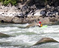 A kayaker shoots the rapids. stock photography