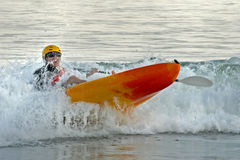 Kayaker in the Surf. A kayaker paddles through the surf and nearly capsizes his kayak Royalty Free Stock Photo