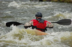Kayaker training on a rough water. Royalty Free Stock Photography