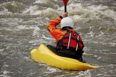 Kayaker training on a rough water. Stock Photo