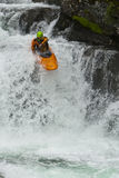 Kayaker in the waterfall. Sportsman - kayaker jumping from the waterfall Stock Images
