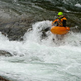 Kayaker in the waterfall. Sportsman - kayaker jumping from the waterfall Royalty Free Stock Photos