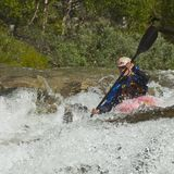 Kayaker in the waterfall Stock Photos