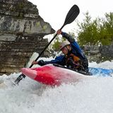 Kayaker in the waterfall Stock Images