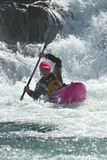 Kayaker on the waterfall in Norway. Woman kayaker on waterfall in Norway Stock Images