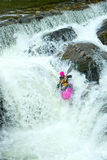 Kayaker on the waterfall in Norway. Woman kayaker on waterfall in Norway Stock Image