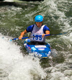 Kayaker in a whitewater race Royalty Free Stock Image