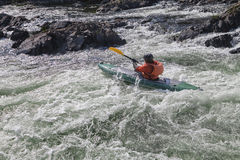 Kayaker in whitewater Stock Images