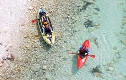 Kayakers on Soca river , Slovenia Royalty Free Stock Photos