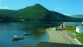 Kayakers amidst fishing boats in Bonne Bay Newfoundland royalty free stock photos