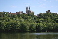 Kayakers Below Georgetown University. Kayakers in the Potomac, rowing in front of Georgetown University in the background. Image taken from a tour boat Royalty Free Stock Images