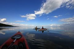 Kayakers in Biscayne National Park, Florida. Biscayne National Park, Florida 01-25-2014 Kayakers enjoy an exceptionally calm afternoon in Biscayne Bay under a royalty free stock photo