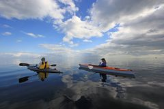 Kayakers in Biscayne National Park, Florida. Biscayne National Park, Florida 01-25-2014 Kayakers enjoy an exceptionally calm afternoon in Biscayne Bay under a stock photos