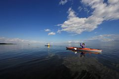 Kayakers in Biscayne National Park, Florida. Biscayne National Park, Florida 01-25-2014 Kayakers enjoy an exceptionally calm afternoon in Biscayne Bay under a stock image