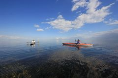Kayakers in Biscayne National Park, Florida. Biscayne National Park, Florida 01-25-2014 Kayakers enjoy an exceptionally calm afternoon in Biscayne Bay under a royalty free stock images
