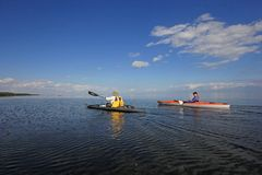 Kayakers in Biscayne National Park, Florida. Biscayne National Park, Florida 01-25-2014 Kayakers enjoy an exceptionally calm afternoon in Biscayne Bay under a royalty free stock photography