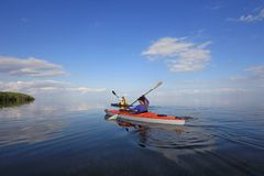 Kayakers in Biscayne National Park, Florida. Biscayne National Park, Florida 01-25-2014 Kayakers enjoy an exceptionally calm afternoon in Biscayne Bay under a stock photography