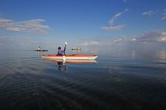 Kayakers in Biscayne National Park, Florida. Biscayne National Park, Florida 01-25-2014 Kayakers enjoy an exceptionally calm afternoon in Biscayne Bay under a stock images