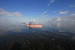 Kayakers in Biscayne National Park, Florida. Biscayne National Park, Florida 01-25-2014 Kayakers enjoy an exceptionally calm afternoon in Biscayne Bay under a stock photo