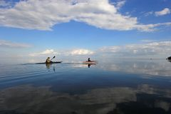 Kayakers in Biscayne National Park, Florida. Biscayne National Park, Florida 01-25-2014 Kayakers enjoy an exceptionally calm afternoon in Biscayne Bay under a royalty free stock photos