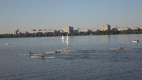 Kayakers in the competition team. Dnepropetrovsk SEPTEMBER 11, 2016: Kayakers in the competition team on City Day in Dnepropetrovsk, September 11, 2016 in stock video footage