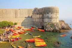 Kayakers and Dubrovnik`s Old Town Wall, Croatia Stock Images