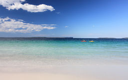 Kayakers enjoy the crystal clear waters Australian Beach stock images