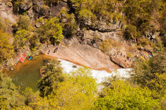 Kayakers going over waterfall. Stock Photo