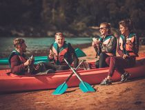 Kayakers having snack Royalty Free Stock Photo