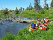 Kayakers Lunch Break. Several kayakers stop for lunch after portaging around tree blocking river access. Little Deschutes River, Central Stock Image