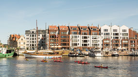 Kayakers on Motlawa River in Gdansk, Poland. Group of kayaking tourists on Motlawa River in Gdansk Old Town; Gdansk marina and waterfront in the background. 27 Stock Photography