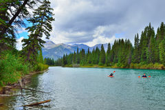 Kayakers on the mountain river in the Canadian Rockies along the Icefields Parkway between Banff and Jasper Stock Photos