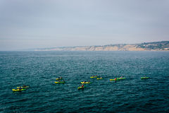 Kayakers in the Pacific Ocean, seen from La Jolla, California. Kayakers in the Pacific Ocean, seen from La Jolla, California royalty free stock photography
