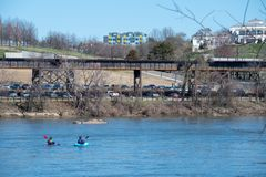 Kayakers paddle down the James River in Richmond, Virginia stock image