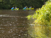 Kayakers rowing on river in Bourdeilles, Dordogne, France Royalty Free Stock Photo