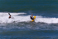 Kayakers Surfing in Rough Sea Royalty Free Stock Photo