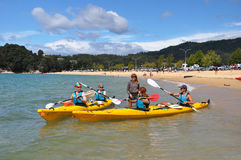 Kayakers Taking Off At Kaiteriteri Beach Royalty Free Stock Photography